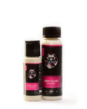 dve priehľadné fľaštičky obsahujúce prípravok na leštenie skiel Shiny Glass béžovej farby s etiketou a logom autokozmetiky Racoon Cleaning Products